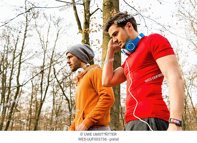 Two sportive young men in forest