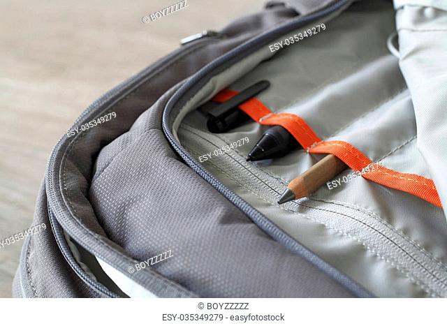 Pen and pencil in canvas laptop backpack