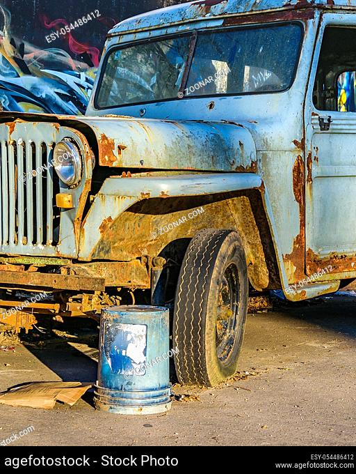 Abandoned old jeep parked at street in montevideo city, uruguay