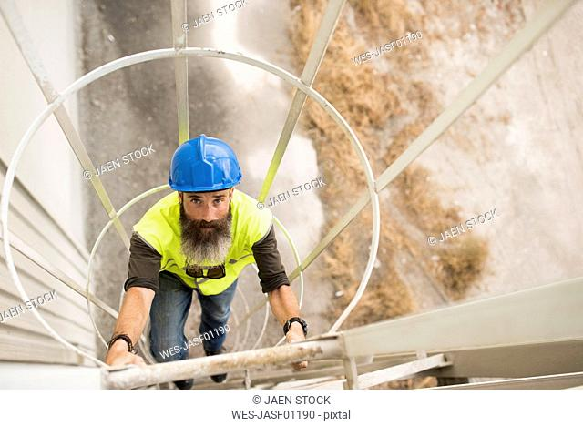 Worker climbing up stairs
