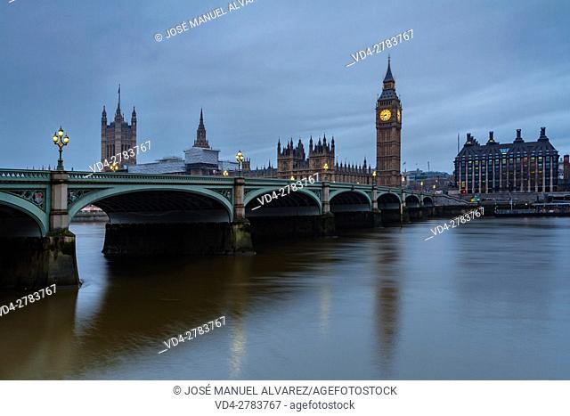 Big Ben, Palace of Westminster, Westminster bridge and thames river during a cloudy day. London, United Kingdom
