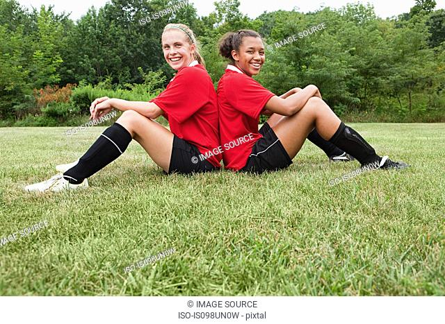Girl soccer players back to back