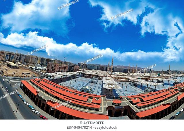 Prophet's Mosque in Medina with blue sky and white clouds in panoramic view