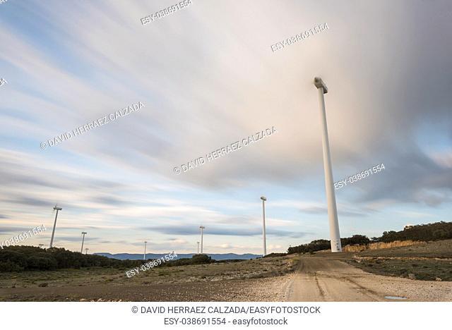 Windmill power generator rotating at dusk