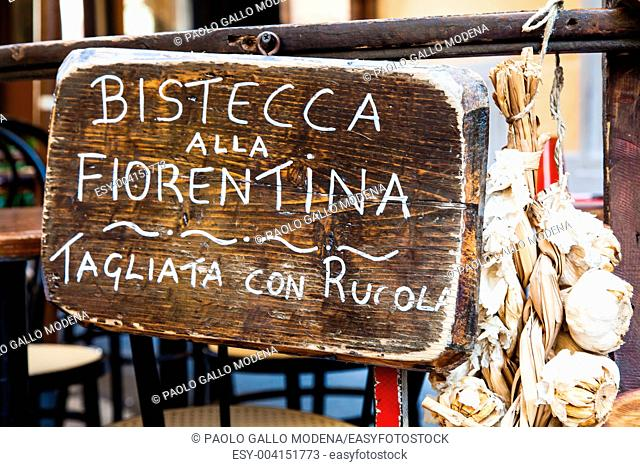 Sign made of wood with Bistecca alla Fiorentina Florence steak words