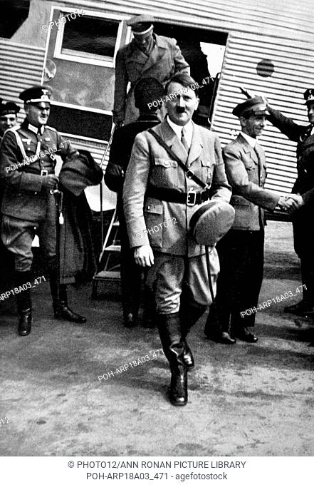 Adolf Hitler arriving at an airfield in Germany accompanied by Dr Josef Goebbels World History Archive