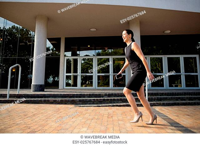 Businesswoman running outside the conference centre