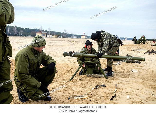 Cadet learns how to navigate SPG recoilless gun during firing training with SPG recoilless guns and Kalashnikov guns at the 169th Training center of Ukrainian...
