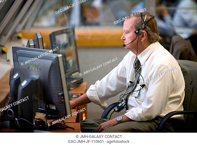 Mike Leinbach, NASA Assistant Shuttle Launch Director for the STS-127 mission, monitors the launch countdown progress and local weather from Firing Room Four of...