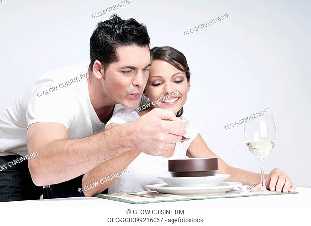 Man feeding soup to his wife