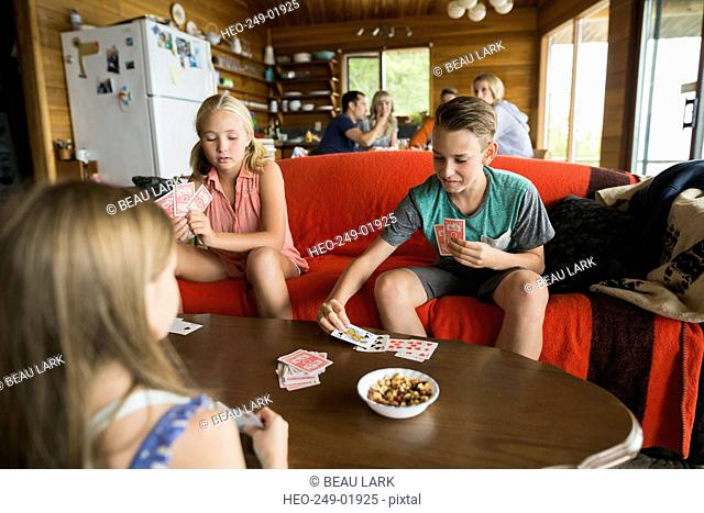 Cousins playing cards in cabin