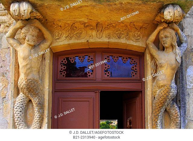 Merman and Mermaid by an entrance door to a house, representing the figures of the Dordogne and Garonne rivers, Rauzan, Entre-Deux-Mers wine region, Gironde