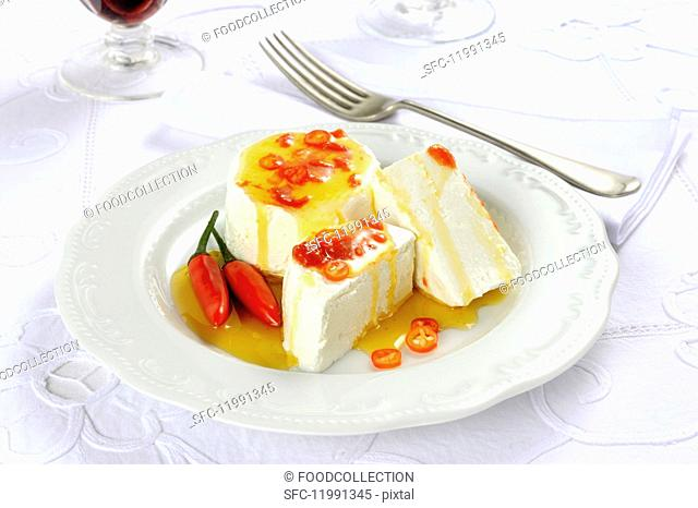 Tomini con peperoncino (Italian soft cheese with chilli)