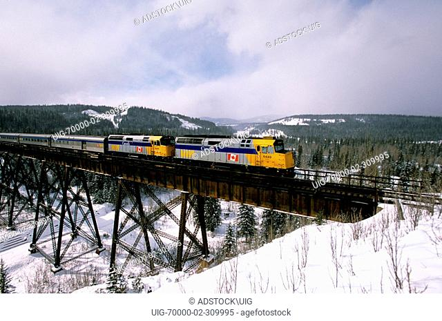 Train crossing the wooden bridge Stock Photos and Images