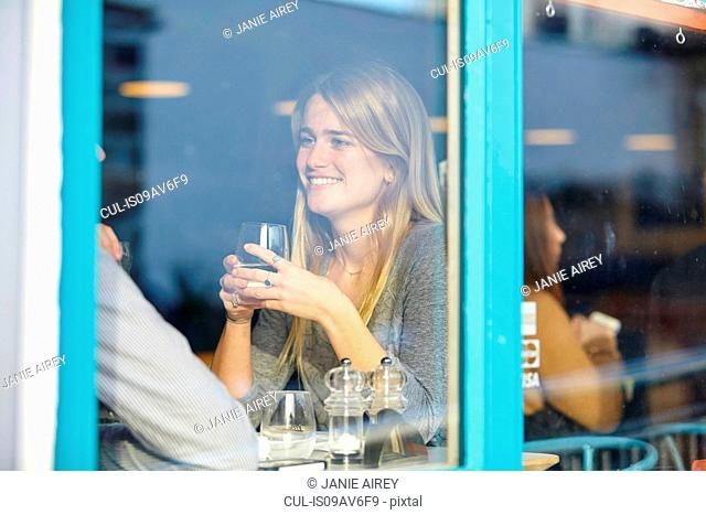 Romantic young couple at cafe having lunch date