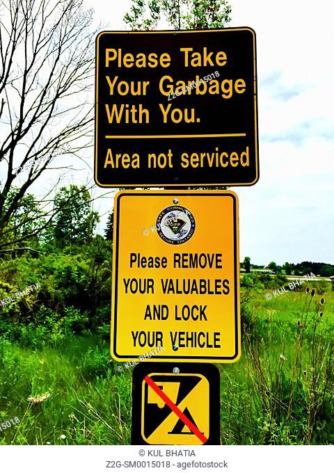 Warning signs, hiking trail, Ontario, Canada