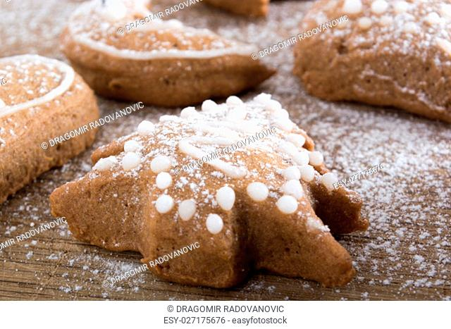 Gingerbread cookies on plate covered with powdered sugar