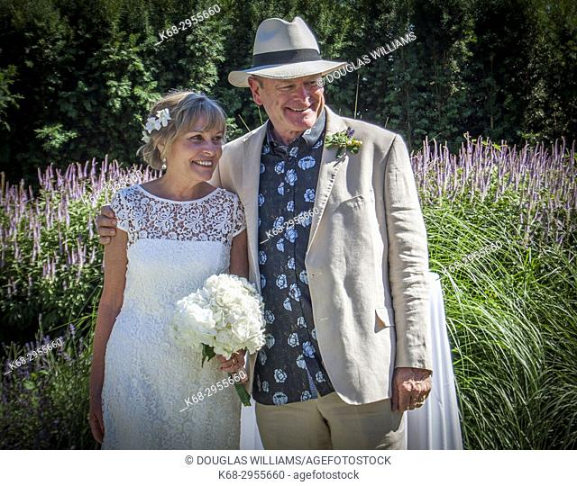 A senior couple, 65, at their outdoor wedding in West Vancouver, BC, Canada