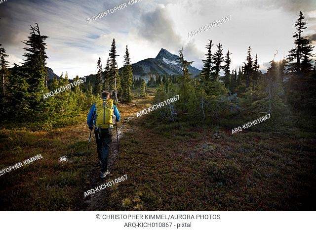 A backpacker hiking towards Jim Kelly Peak, British Columbia, Canada