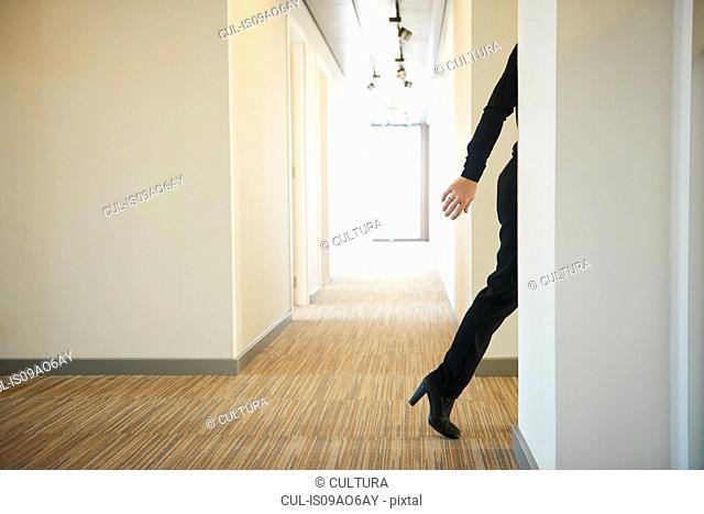 Woman walking across corridor