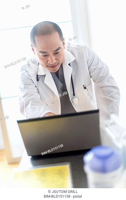 Korean doctor using laptop in office