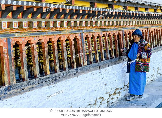 Woman praying at the monastery, Bhutan