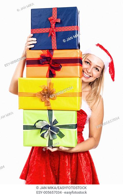 Happy Christmas woman carrying many presents, isolated on white background