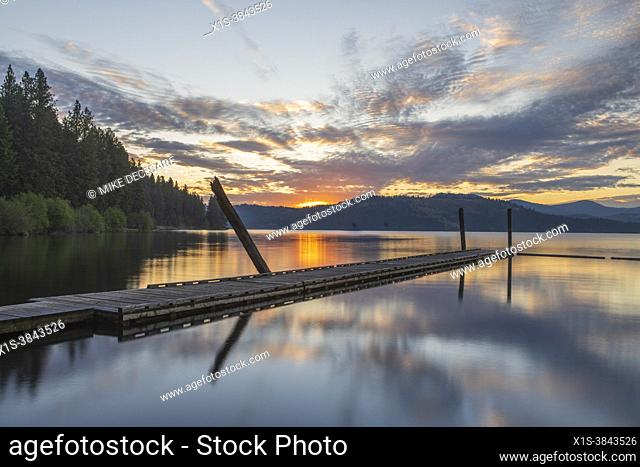 Morning sun breaks over the mountains in Heyburn State Park and reflects beautiful morning colors on Lake Chsatcolet, in North Idaho