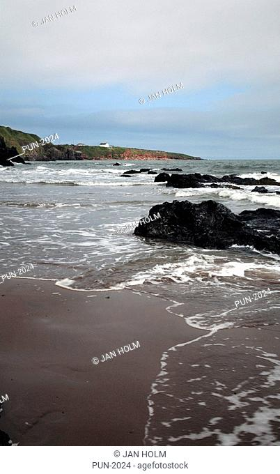 Beach, sea and rocks at St Cyrus