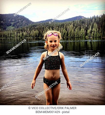 Caucasian girl playing in Lost Lake, Oregon, United States