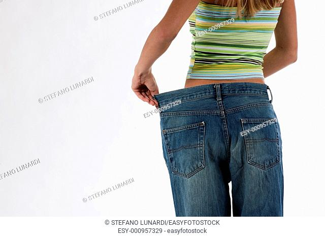 Young woman became skinny and wearing old jeans