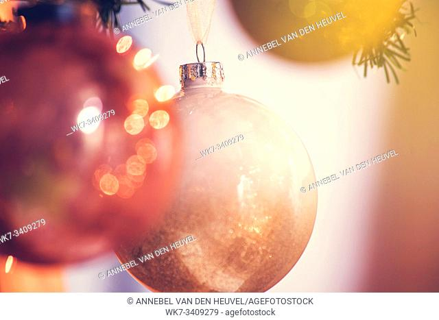 Gold Christmas balls decoration in tree, beautiful sparkles close-up winter holiday, christmas card