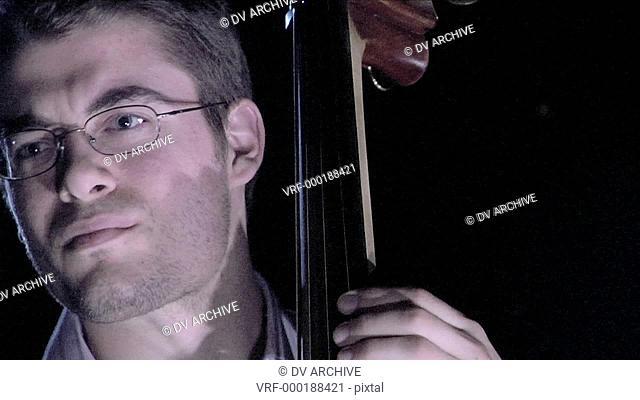 A man plays the bass fiddle