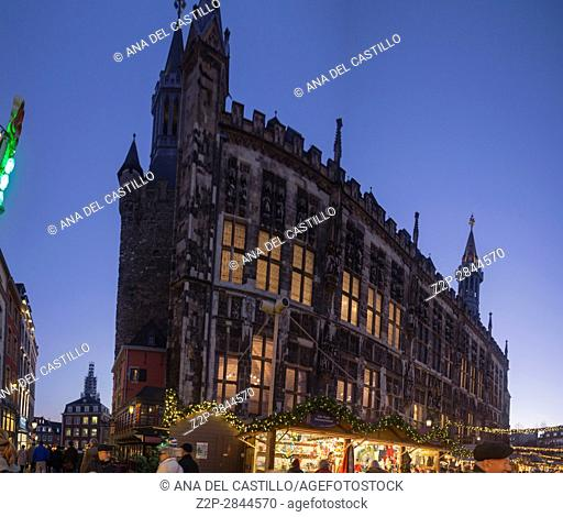 Town hall at twilight in Aachen traditional christmas xmas market square on December 5, 2016 in Germany