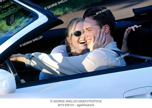 happy couple in a convertible