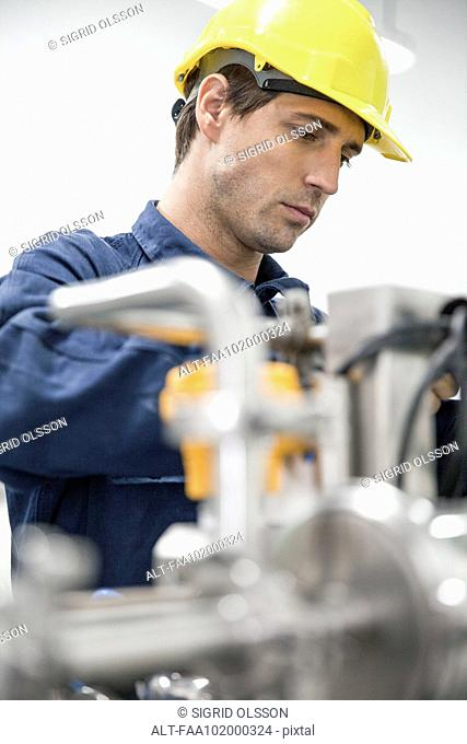 Blue-collar worker at work in factory