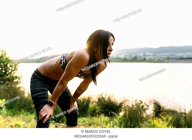 Woman taking a breather at training