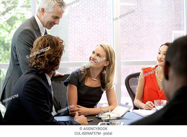 Business colleagues enjoying meeting