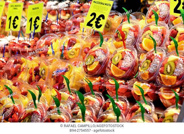 Frash fruit salads at La Boquería market, Barcelona. Catalonia, Spain