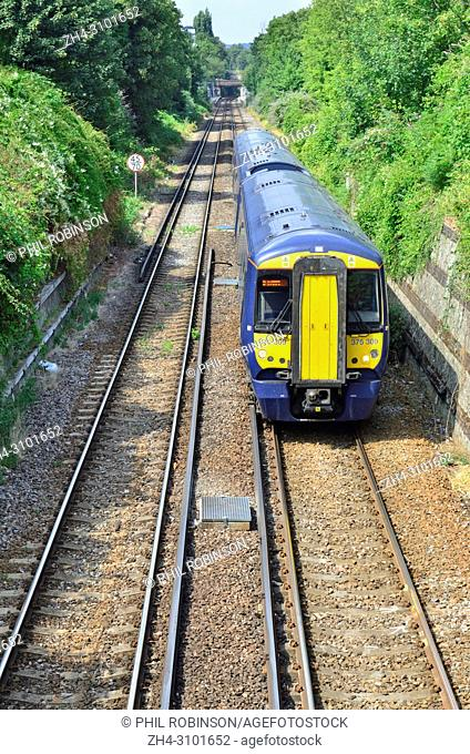 British Rail Class 375 two unit train in a cutting between Maidstone Barracks and Maidstone West stations, Kent, England