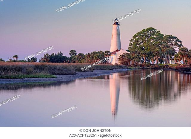 St. Marks Lighthouse reflected in a slough at dawn, St. Marks NWR, Florida, USA