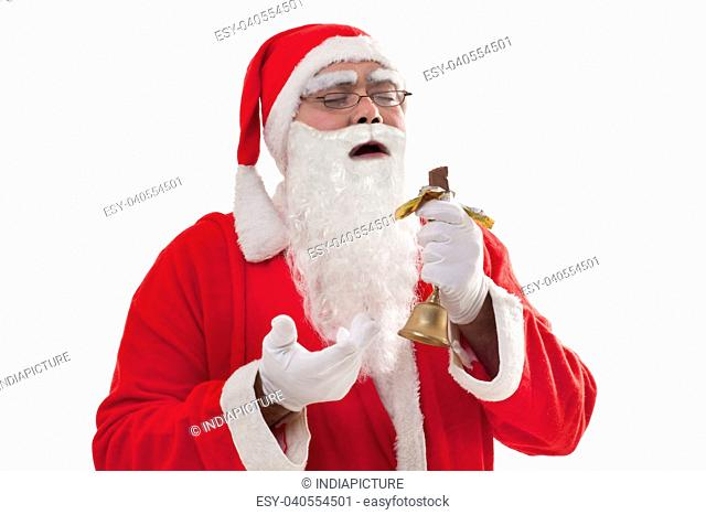 Front view of Santa Claus holding chocolate bar with eyes closed over white background