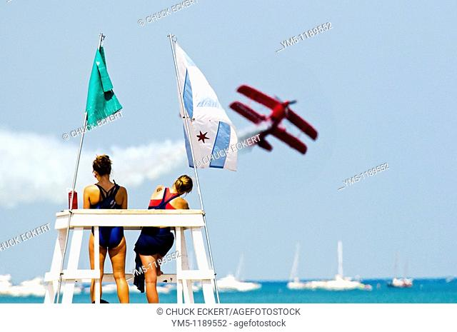 Lifeguards watching stunt plane crabbing at the annual Chicago Air and Water Show from North Ave Beach