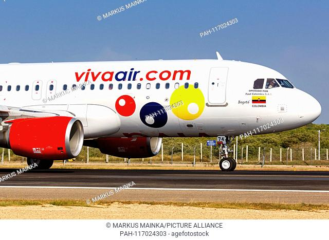 Cartagena, Colombia – January 27, 2019: Vivaair Airbus A320 airplane at Cartagena airport (CTG) in Colombia. | usage worldwide. - Cartagena/Colombia