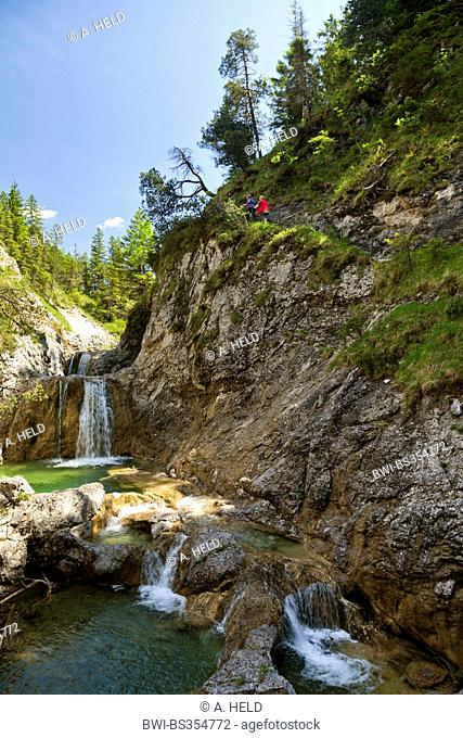 hiking trail along mountain creek with small waterfalls, Austria, Tyrol, Archbach