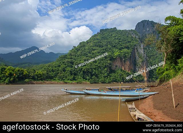 View of excursion boats at the Pak Ou Cave on the Mekong River near Luang Prabang in Central Laos