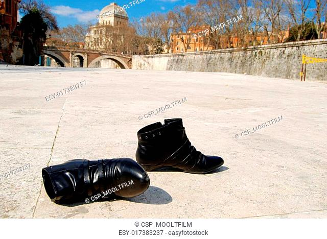 Black shoes on the white stone outdoors