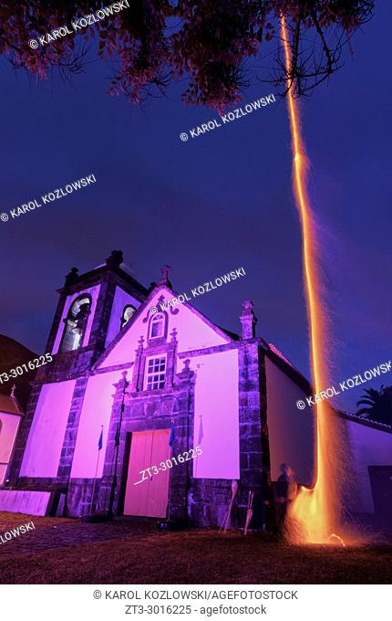 Holy Spirit Festivity Fireworks by the Church in Manadas, twilight, Sao Jorge Island, Azores, Portugal