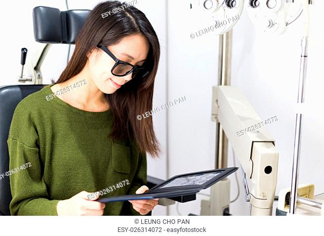 Woman checking sense of three dimensional on eye clinic
