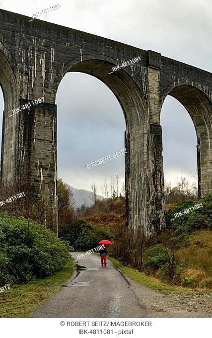 Glenfinnan Railway Viaduct, with hiker, Glenfinnan, West Highlands, Scotland, Great Britain, Scotland